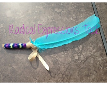 Custom turquoise beaded feather