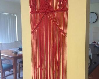Red macrame wall hanging