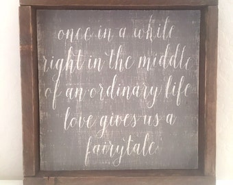 Love gives us a fairytale wood sign