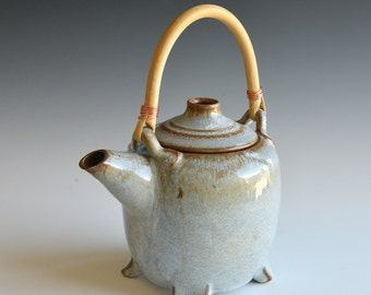 Handthrown teapot in stoneware clay with rattan handle