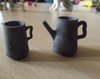 vintage metal teapot and milk jug