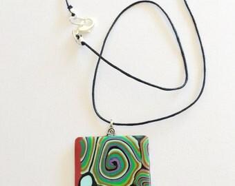 Polymer clay swirl pendant