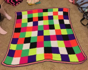Brighly colored patchwork afghan