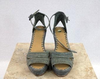 Hand woven seafoam high heel raffia shoes.