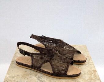 Handwoven mocha raffia sandals.