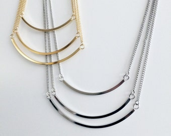 Multilayered 3 tier multi chain crescent necklace with gold bands