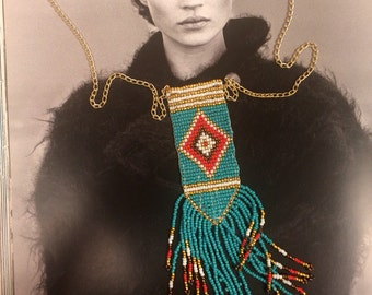 Long beaded native american breastplate with bead fringe and gold chain