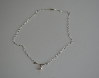 delicate silver with freshwater pearl pendant