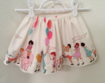 Girls Toddlers designer's skirt,  Children at Play on Parade, Michael Miller, ivory, 100% cotton, non -roll elastic, 2T 3T 4T 5T,