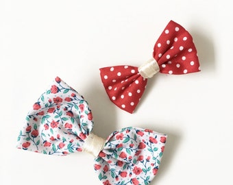 A Pair of Bow Hair Clips in Flowers and Red Polkadots pattern for Babies or Bigger Girls