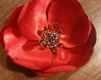 Beautiful satin poppy brooch