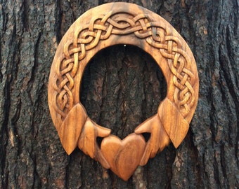 Claddagh hand carved from mahogany wood