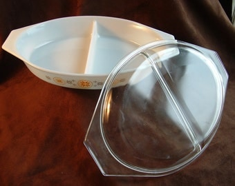 Pyrex Town and Country divided baking dish with lid.  Gold and brown pattern on white with clear cover.