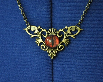 Bronze Metal Scroll Necklace with Red Creature's Eye