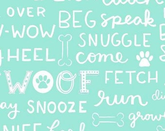 Dog Lover Words on Aqua cotton fabric by Clothworks