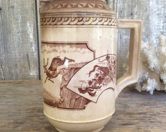 Antique brown transferware pitcher with unusual form and Aesthetic pattern