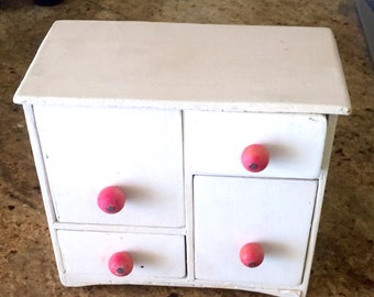 Small chest of white doll, pink buttons, has drawers