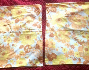 2 pillowcases, flowers and oranges on white background, vintage 70s