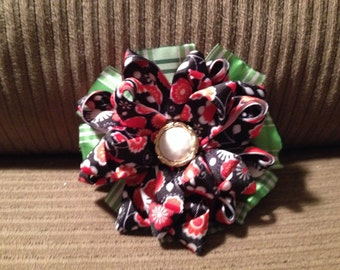 Red and black ribbon flower hair clip