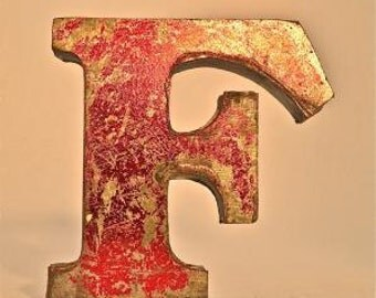 A fantastic vintage style metal 3D red letter F
