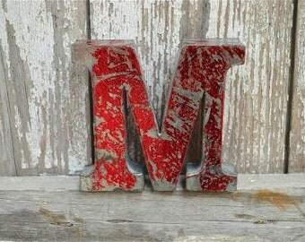 A fantastic vintage style metal 3D red letter M