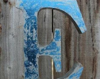 Medium vintage style 3D blue letter E