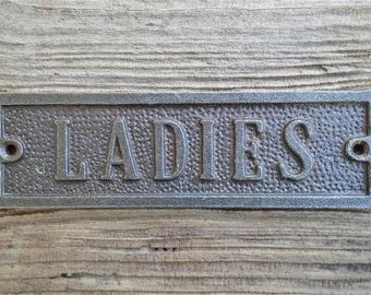 A solid cast iron antique style Ladies toilet sign WH13