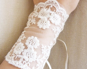 Sleeves for flowery ivory lace wedding