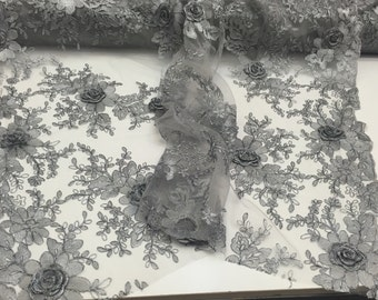 Daisy flower design mesh metallic gray. Sold by the yard