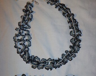 grey black necklace and bracelet