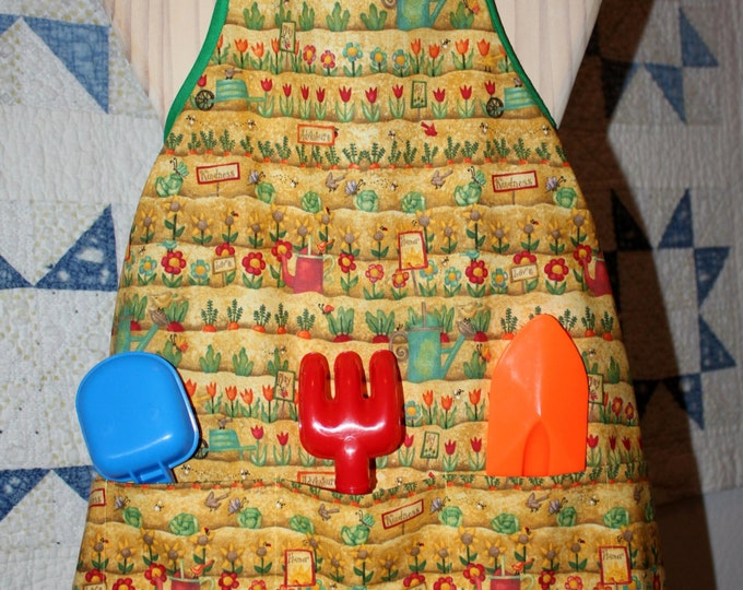 HALF PRICE ** Childs Gardening Apron. Yellow Orange Green Red Garden Print, with Deep Pockets. Gardening Tools and Gloves included.