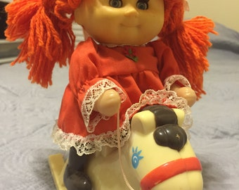 Vintage Cabbage Patch Doll riding horse