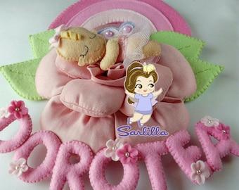 Stitchable baby asleep on pink