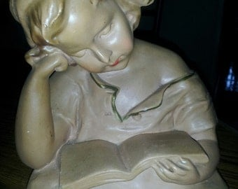 antique sttue of young nurse reading a book signed