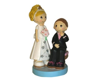 Bride and groom cake sitting