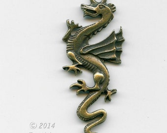 Cast antiqued brass dragon pendant 50X15mm. Pkg. of 1. b9-2283(e)