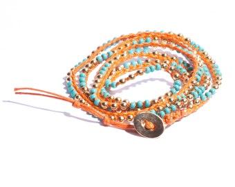 Orange Chanluu Turquoise and gold beaded wrap bracelet.