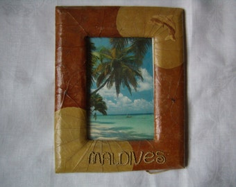 Picture frame craft, Maldives, decorated with dried leaves.