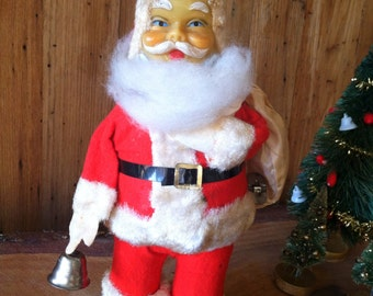 SALE: This wind up Santa with bell is a mechanical wonder from days gone by