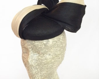 Black sinamay fascinator with ivory and black silk abaca bow