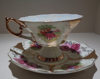 Vintage Ivory Iridescent Gilded Couple In Garden Floral Motif Tea Cup & Saucer