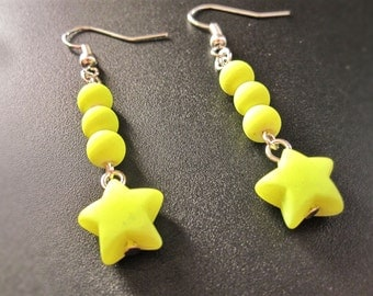 Fluorescent yellow star earring