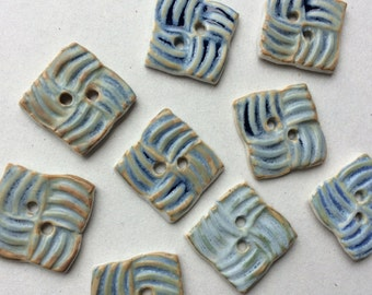 Burnished green, golden, touches of blue square pinwheel-pattern 7/8-in. porcelain buttons
