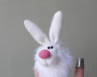White Bunny. Hare. Penlight theatre. Finger puppets. Thimble. Little toy. Small animal.