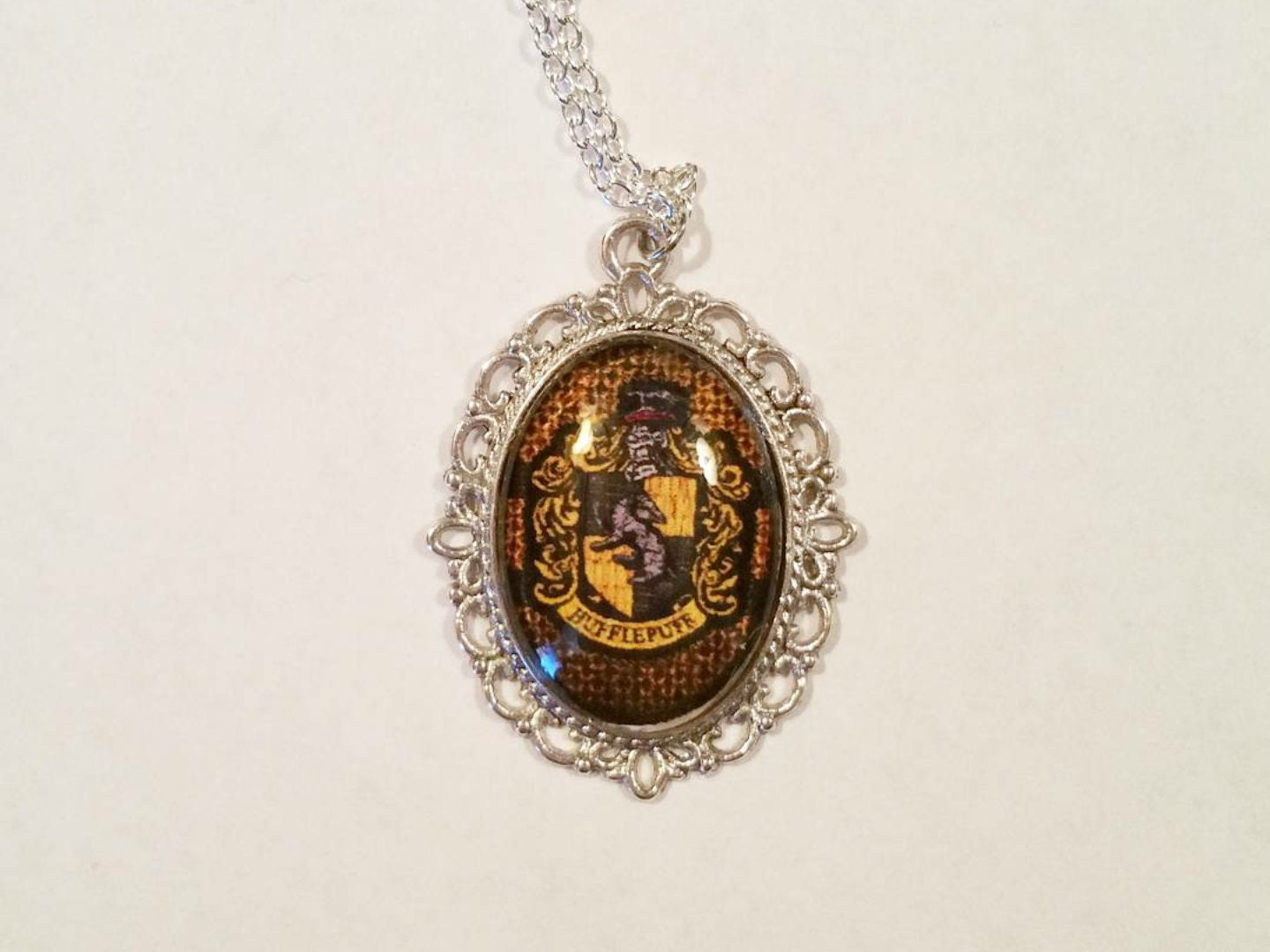 harry potter hufflepuff necklace by wildheartedcreations