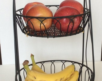 Vintage 2 tier metal and wicker fruit stand. Metal and wicker storage for vegetables. Farmhouse style fruit or vegetable holder.