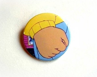 Arthur's fist - pinback button or magnet 1.5 Inch
