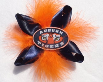 Auburn Tigers clip-on hair accessory with feathers