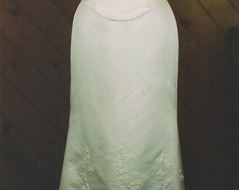 New with tags, Alfred Angelo, ivory, form fitting, satin wedding gown, size 10 with embroidery, pearls and beads.