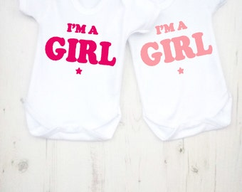 Baby announcement I'm a girl bodysuit. Printed lovingly by hand on 100% cotton.
